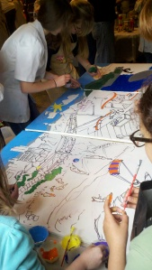 Teenagers creating the panels for the coal train transformation scene.