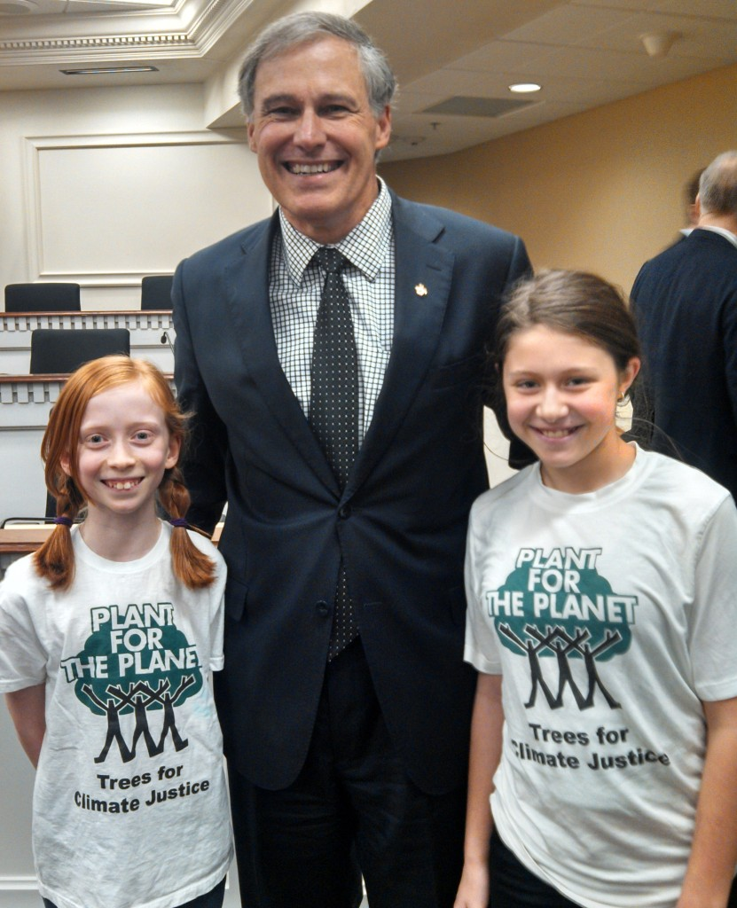 Ambassadors Wren and Zoe from Plant-For-The-Planet share a moment with Washington Governor Jay Inslee in Olympia.