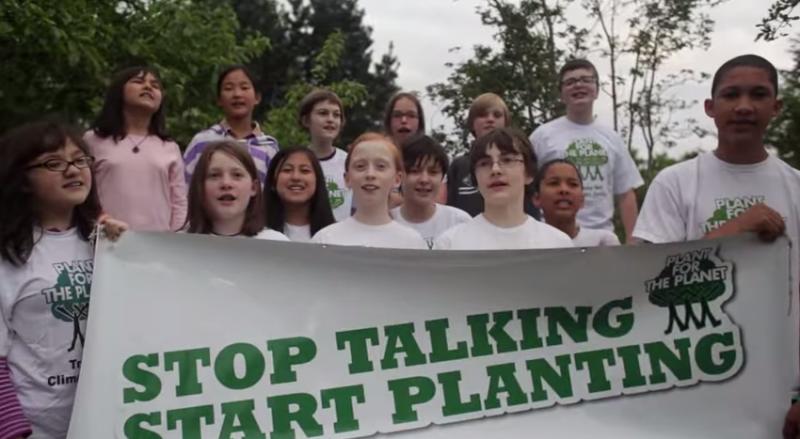 "PFTP Ambassadors with ""Stop Talking Start Planting"" banner"
