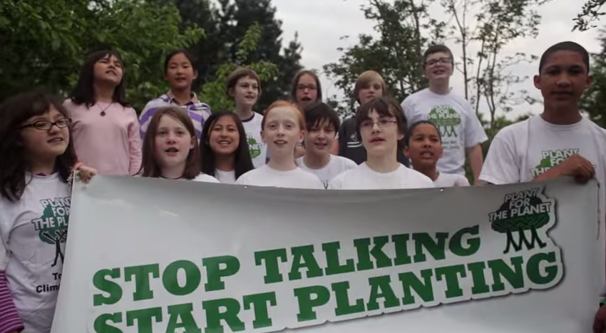 "PFTP Ambassadors with ""Stop Talking Start Planting"" banner"