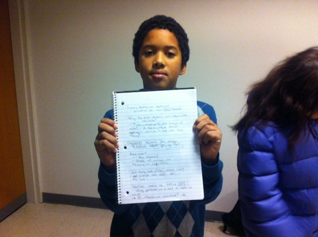 One of the plaintiffs, 10-year-old Adonis Piper, showed off his notes at a court hearing. Photo Credit: Sydney Brownstone
